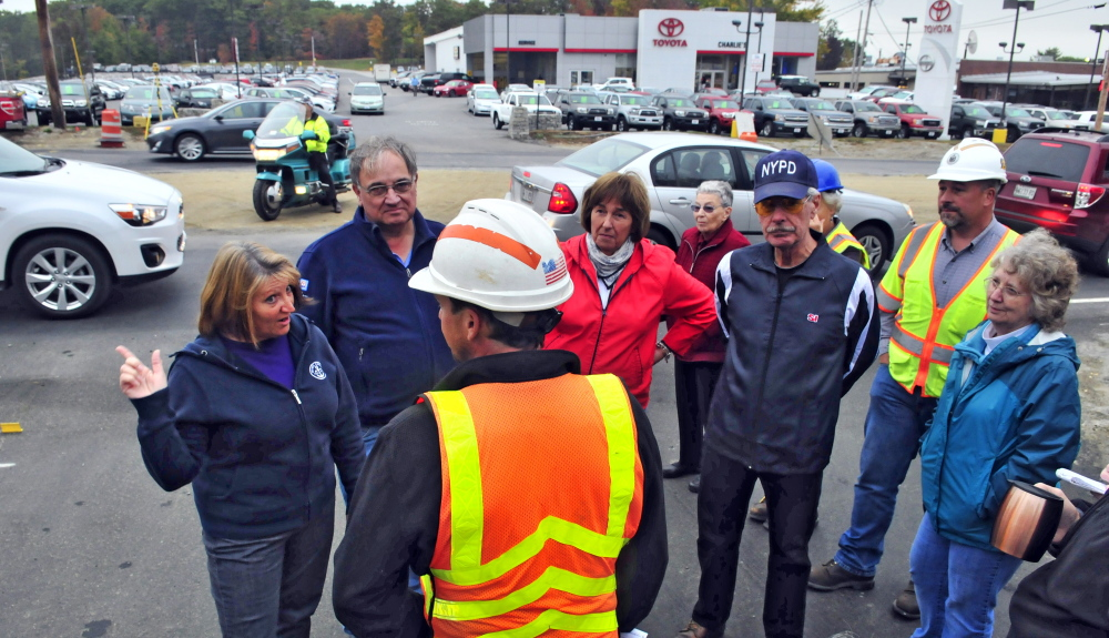 Mary Lou Lane, far left, and other Smith Street residents meet with Maine Department of Transportation engineer Seth Wills, center, on Tuesday at the corner of Smith Street and Western Avenue in Augusta. Residents expressed concern about not being able to see approaching traffic when they pull out of Smith Street onto Western Avenue.
