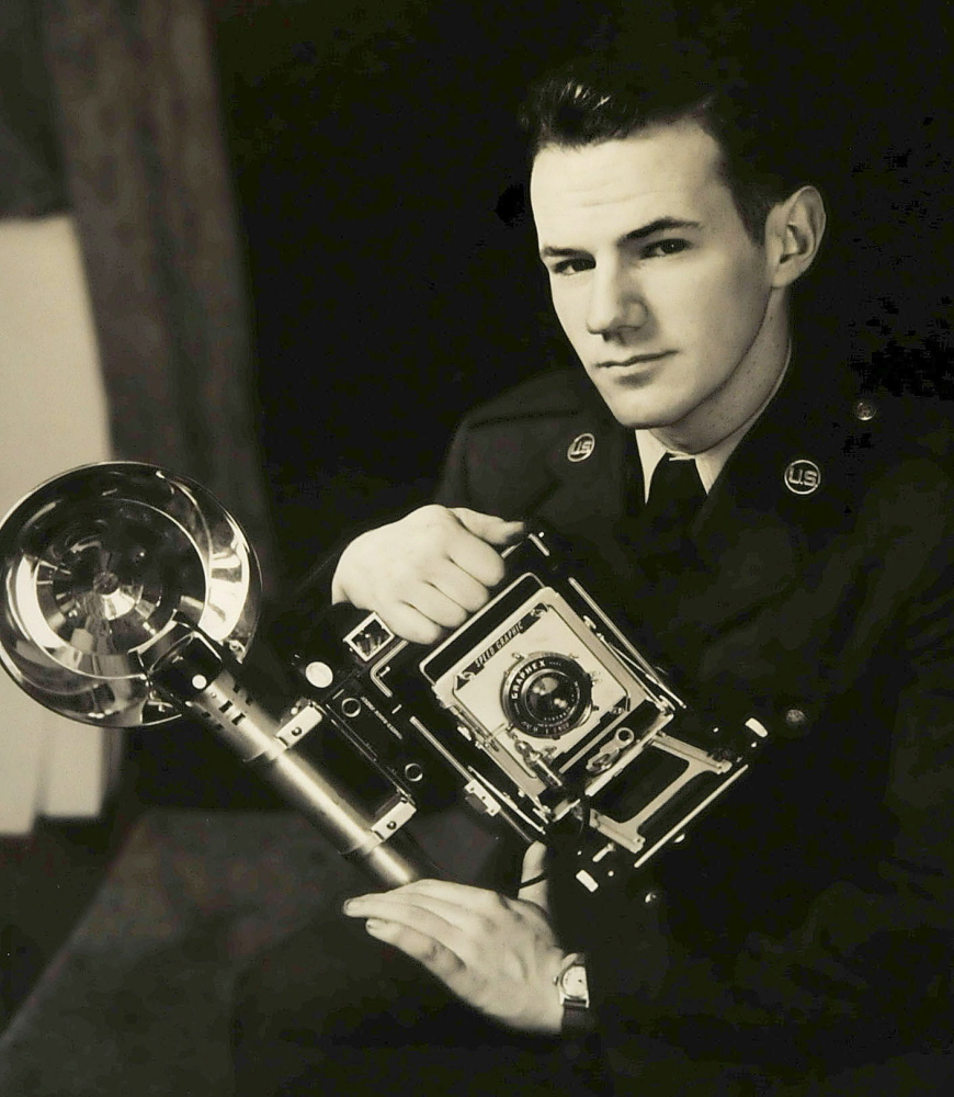This self-portrait of Galen Leavitt with the camera he used during the Korean War is on display along with other photographs at an Oakland Library exhibit that opens Wednesday