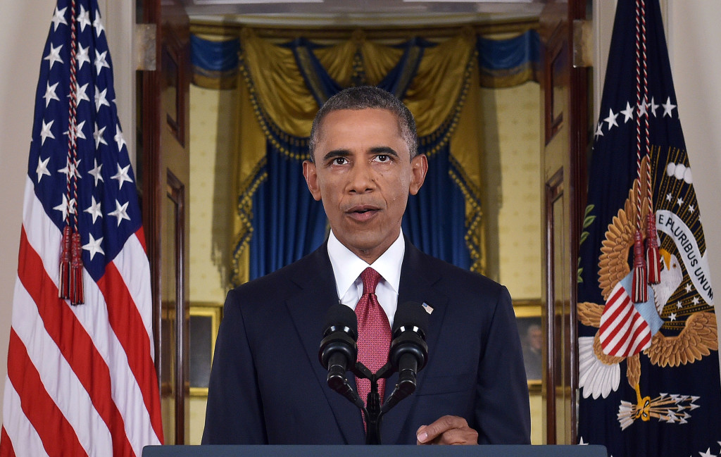 """President Obama addresses the nation from Cross Hall in the White House on Wednesday night. In a major reversal, Obama ordered the United States into a broad military campaign to """"degrade and ultimately destroy"""" militants in two volatile Middle East nations, authorizing airstrikes inside Syria for the first time, and an expansion of strikes in Iraq."""