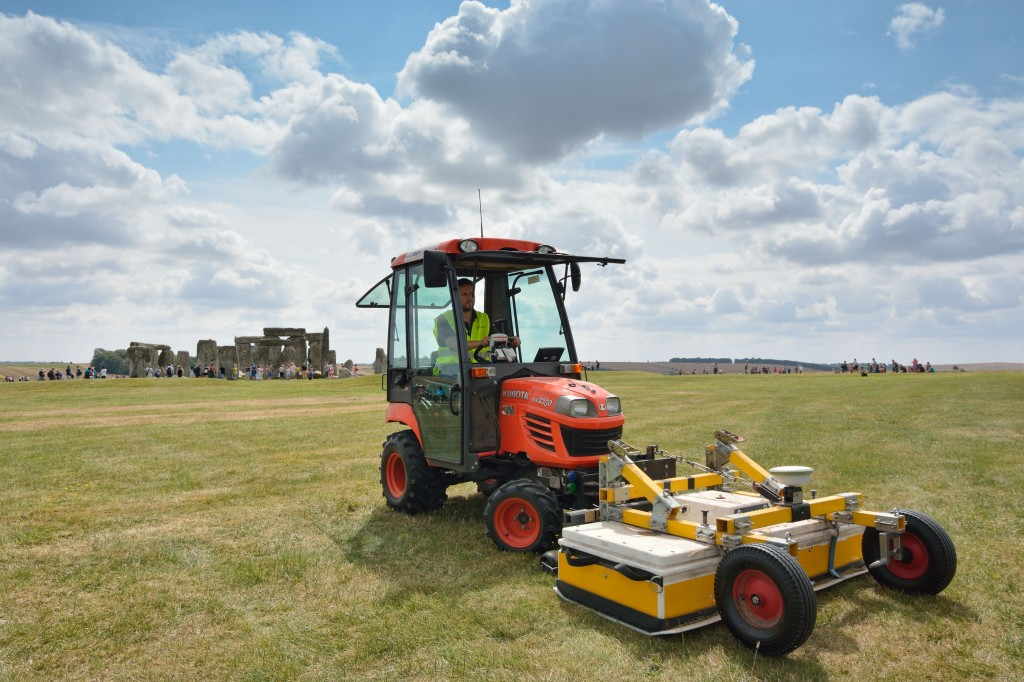 An undated photo made available by the University of Birmingham, England, shows a tractor pushing the surveying vehicle that was used to scan the Earth near Stonehenge.