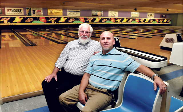 Sparetime Recreation bowling alley owner Andy Couture, left, and the Rev. Craig Riportella of Centerpoint Community Church sit at the Waterville bowling alley. The school will buy the business in January, but will keep the alley operating until April before converting the building for church needs.