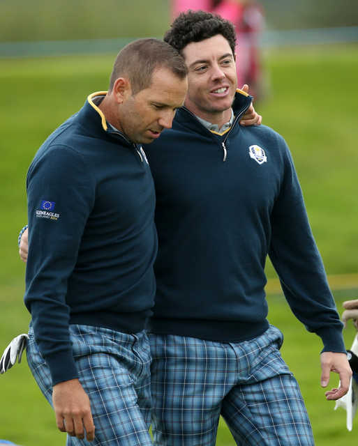 Europe's Rory McIlroy and Sergio Garcia, left,  walk along the 15th fairway during a practice round Tuesday ahead of the Ryder Cup at Gleneagles, Scotland.