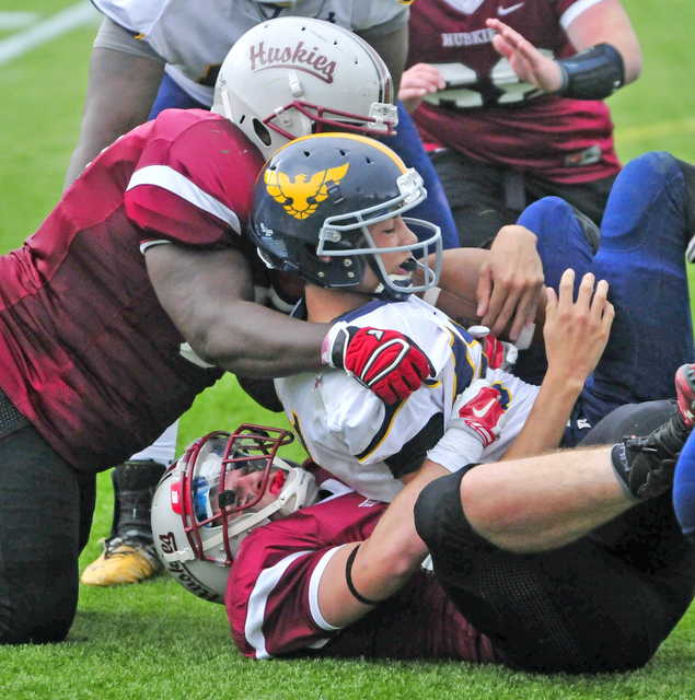Kents Hill's Walter Washington, left, and Adam Gigliotti bring down Hyde School's Toby Taradeina during a game Saturday at Kents Hill School in Kents Hill. The two are postgraduates on the team.