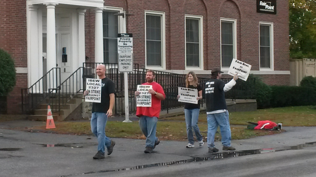 FairPoint workers strike outside building on State Street in Augusta Friday morning. Staff photo by Susan Cover.