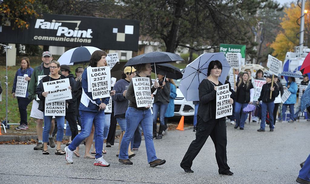 Fairpoint workers on Friday strike march at corner of Davis Farm and Riverside roads in Portland after a walkout at midnight from Fairpoint Communicationslocations around Northern New England. Gordon Chibroski/Staff Photographer