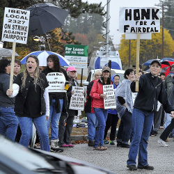 Fairpoint workers on strike march at corner of Davis Farm and Riverside roads after a walkout at midnight from Fairpoint Communicationslocations around Northern New England. (Photo by Gordon Chibroski/Staff Photographer)