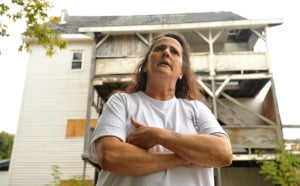 Kerry Vargas, 50, talks about the dangers of living next to the condemned building at 26 Gold St. in Waterville. The city of Waterville is preparing to seize the building and demolish it.