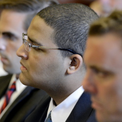 Anthony Pratt Jr. is flanked by his attorneys, Dylan Boyd, left, and Peter Cyr, on Monday at the Cumberland County Court House in Portland. Pratt's murder trial continued Wednesday.