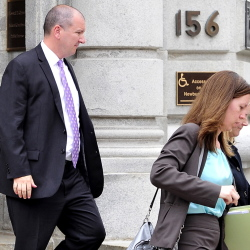 Jeffrey Burnham leaves U.S. District Court in May with his lawyer, Sarah Churchill, after being charged with felony theft. He pleaded guilty in June and was sentenced Wednesday.