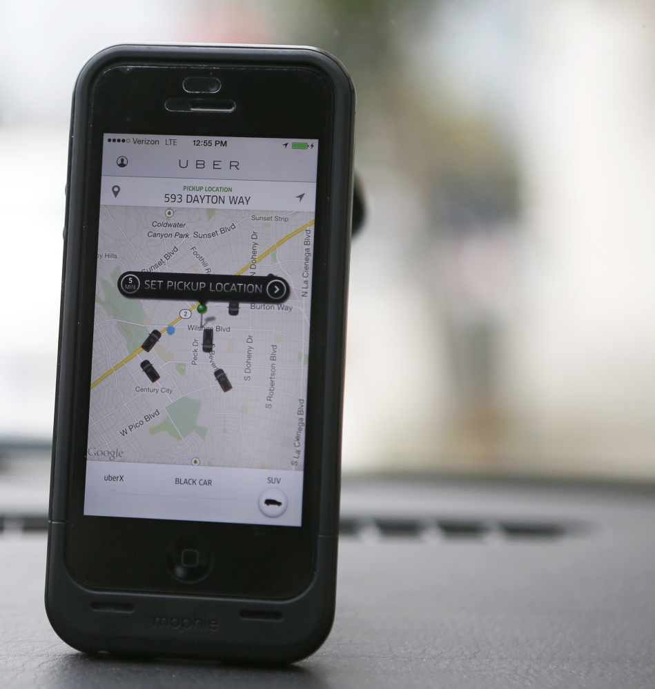 An Uber app is seen on an iPhone in Beverly Hills, Calif. Uber has entered markets in more than 200 cities, ranging from its hometown of San Francisco to Berlin to Tokyo, and arrived in Portland at noon Thursday.