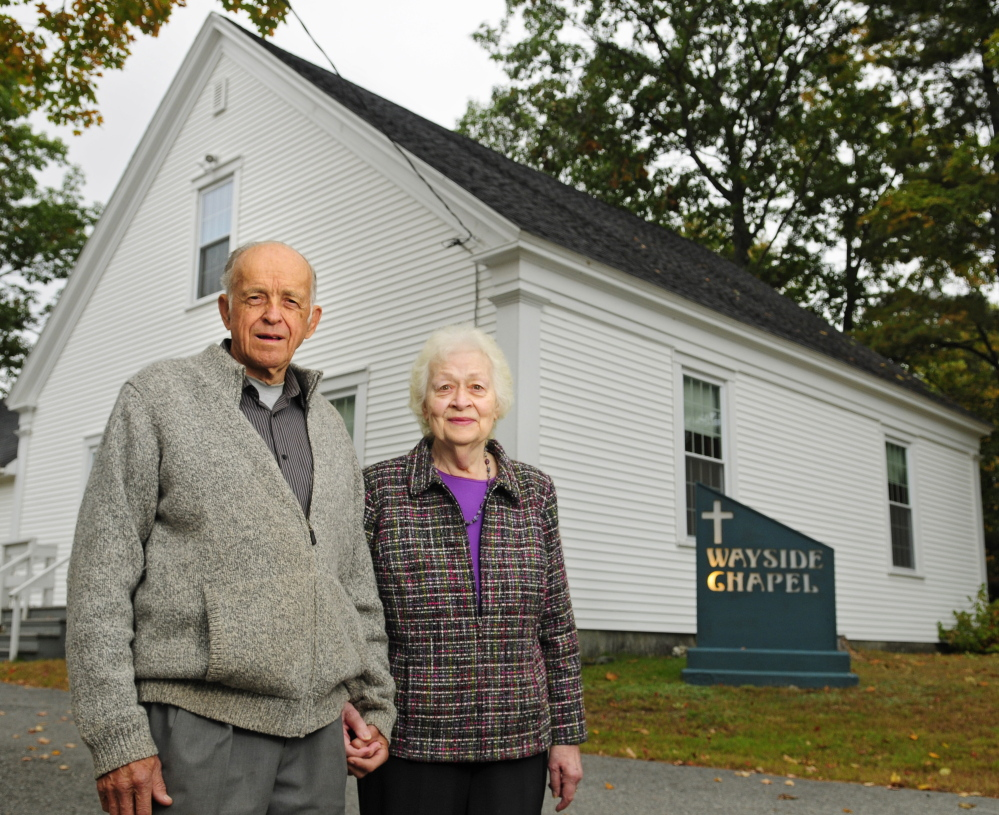 The Rev. Fred and Ella Benner stand outside Wayside Chapel on Wednesday in West Gardiner. When the Rev. Benner opened the church in 1955, the building, now two centuries old, had no electricity. It has been updated and expanded since then.