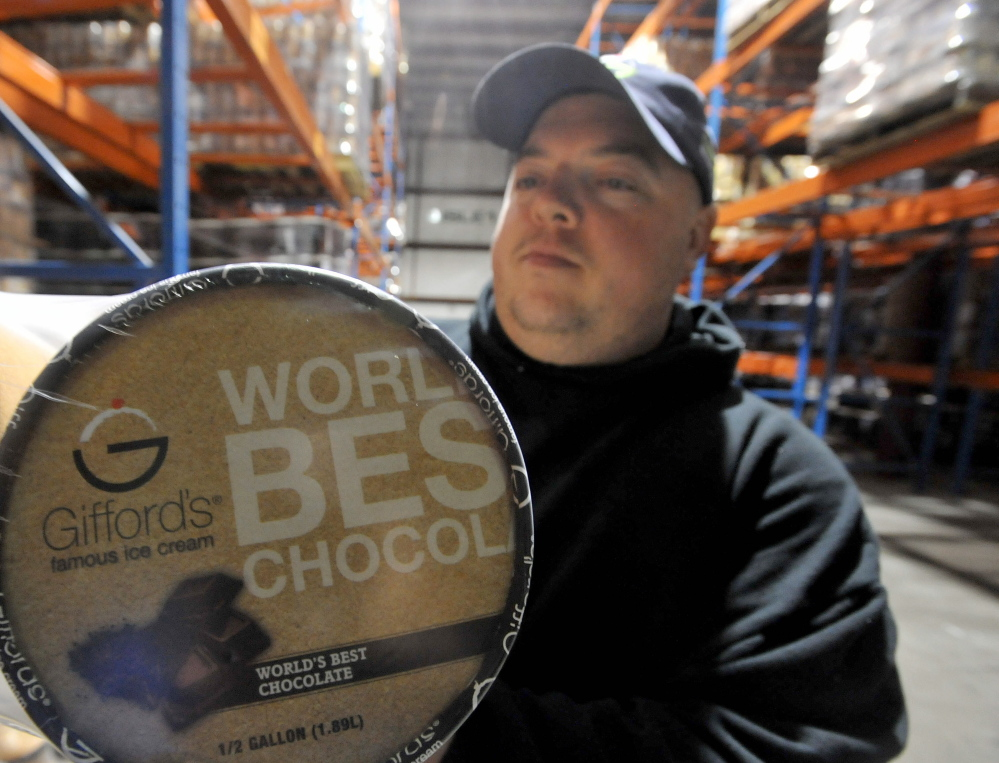 Todd Parker, shipping and receiving manager at Gifford's Ice Cream manufacturing plant in Skowhegan, holds a package of chocolate ice cream ready to ship on Thursday. Gifford's Ice Cream recently was honored as the maker of the best chocolate ice cream entered in a contest conducted by a Wisconsin trade group.