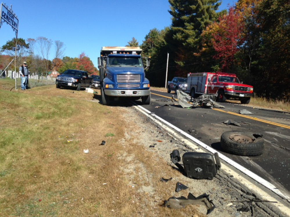 Debris lies scattered along Route 43 in Anson after a pickup truck ran into a dump truck Thursday morning.