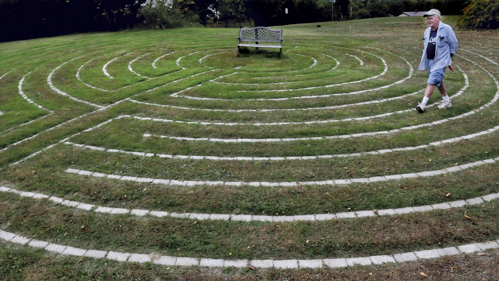 "Mike Monahan walks the paths of the Labyrinth he created at his home in Farmington where people can be alone to concentrate on their thoughts. ""It is  a tool to meditate,"" Monahan said."
