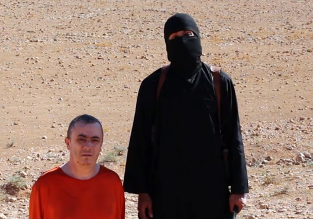 This undated image shows a frame from a video released Friday, Oct. 3, 2014, by Islamic State militants that purports to show the killing of journalist Alan Henning by the militant group.