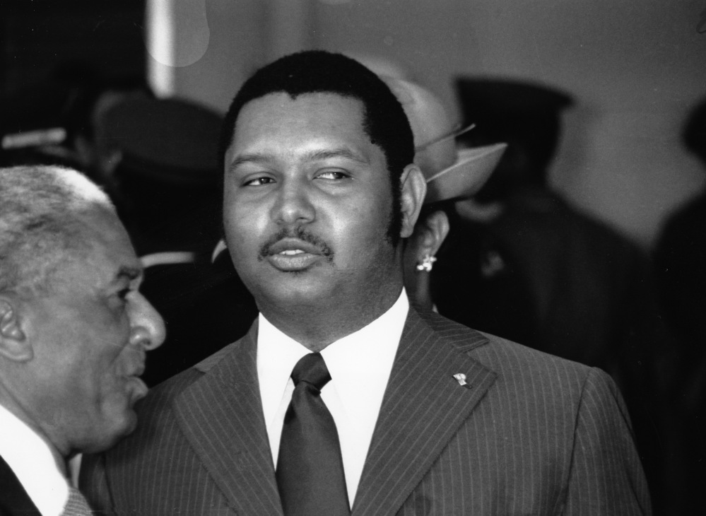 In this April 25, 1975 file phot, Haitian President Jean-Claude Duvalier welcomes Zambian President Kenneth Kaunda at the Port-au-Prince airport in Haiti.