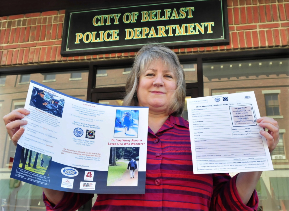 Belfast mother Linda Lee holds a brochure and form for The Wanderers Database on Thursday at the Belfast Police Department. Lee came up with the idea of having identifying information available to first responders in the event people with autism become lost. Her son Christian has autism.