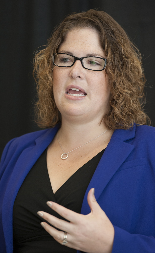 Emily Cain speaks to a group during a candidate luncheon for Fusion Bangor, a business organization, in September at the Cross Insurance Center in Bangor.