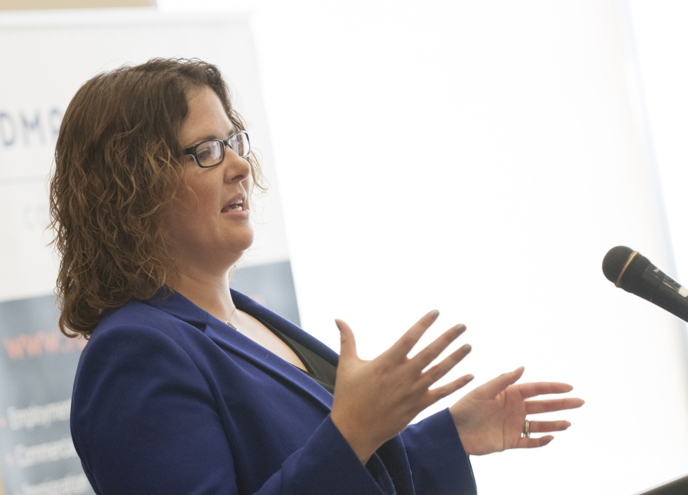 Emily Cain speaks to a group during a candidate luncheon in September for Fusion Bangor, a business organization, at the Cross Insurance Center in Bangor.