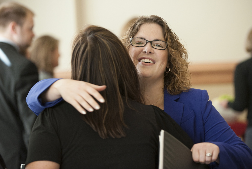 Emily Cain hugs Carin Sychterz, the Bangor Region Chamber of Commerce program coordinator, before a candidate luncheon in September for Fusion Bangor, a business organization, at the Cross Insurance Center in Bangor.
