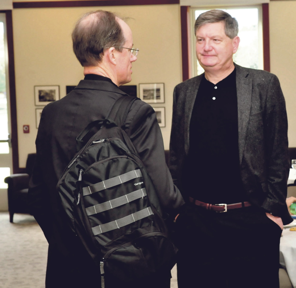New York Times investigative reporter James Risen, right, speaks with former senior executive of the National Security Agency and whistleblower Thomas Drake at a journalism conference at Colby College in Waterville on Sunday. Risen received the annual Elijah Parish Lovejoy Award for courageous journalism.