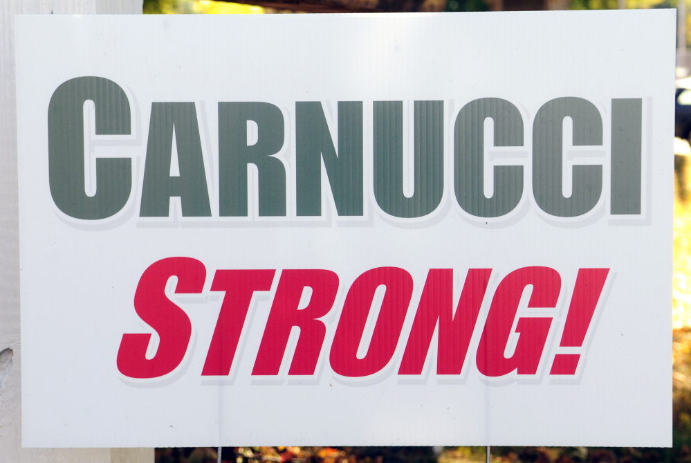 Signs with the Carnucci Stong slogan in support of Jaime Carnucci were on display Thursday at the Winthrop police station where Jaime Carnucci's mother, Charle Clark, works. The signs have sprung up around town since Augusta, when Carnucci suffered a spinal cord injury in a diving accident.