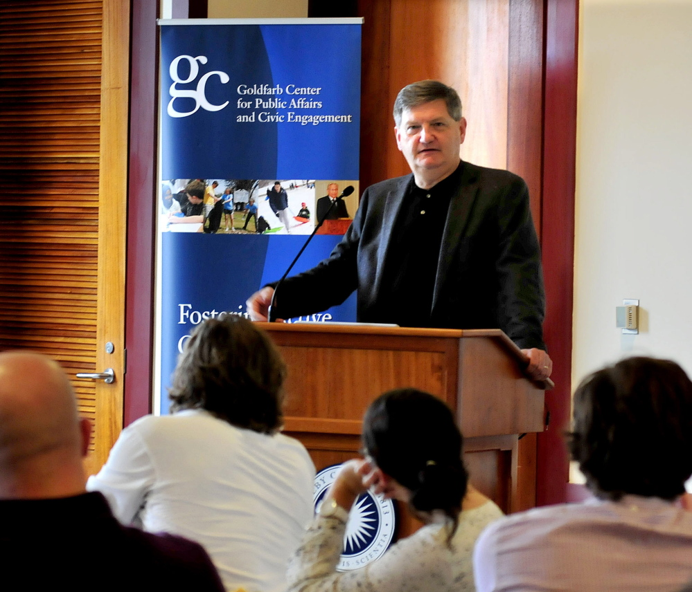 New York Times investigative reporter James Risen speaks with journalism students on Sunday at Colby College in Waterville. Risen is this years recipient of the Elijah Parish Lovejoy award for journalism.