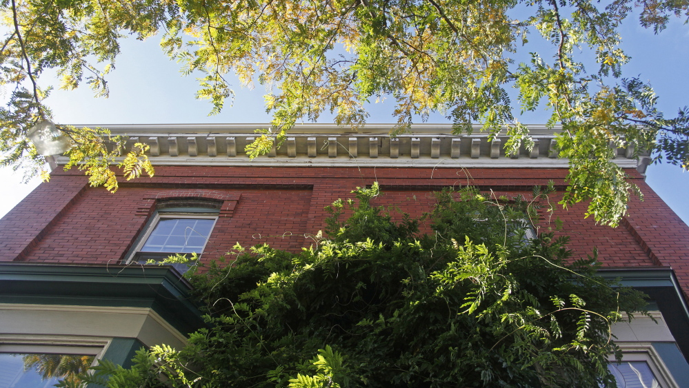 The ornate roofline at 147 Congress St. on Munjoy Hill in Portland where the owners are asking to make it a historic landmark to protect it from ruin after it sells.)