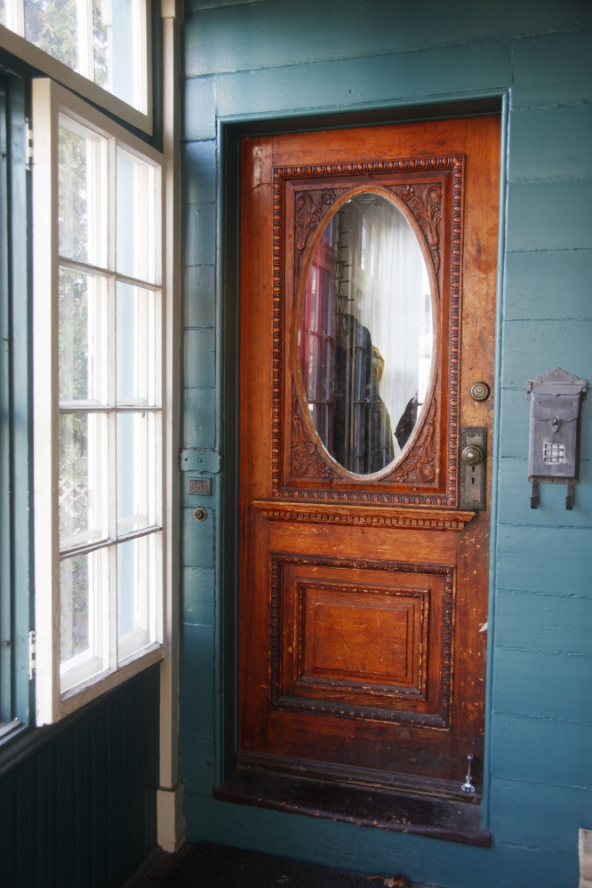 The front door at 147 Congress St. on Munjoy Hill in Portland where the owners are asking to make it a historic landmark to protect it from ruin after it sells.