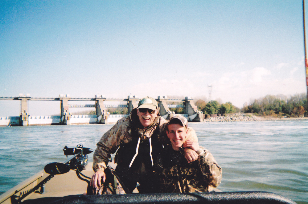 This 2011 photo provided by the Kassig Family, Abdul-Rahman Kassig, right, poses for a photo while fishing with his father, Ed Kassig, near the Cannelton Dam on the Ohio River in southern Indiana.