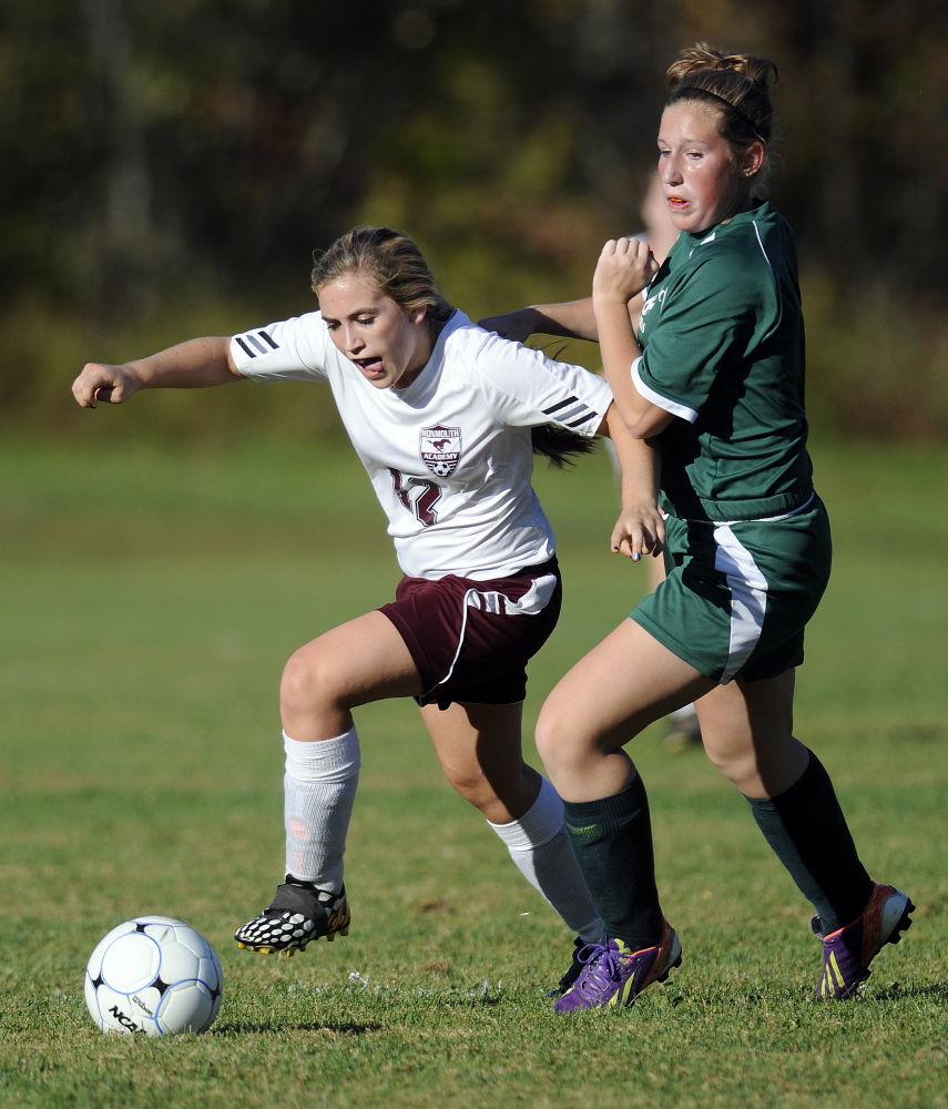 Monmouth's Sydney Wilson gets past Carrabec's Bailey Dunphy during a Mountain Valley Conference game Monday in Monmouth. The Mustangs cruised to a 7-0 victory.