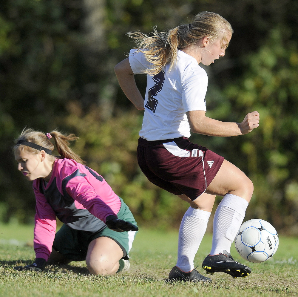 Monmouth Academy's Haley Fletcher drives Monday past Carrabec's Stephanie Cassaboom during a Mountain Valley Conference soccer game Monday in Monmouth. The Mustangs won 7-0.