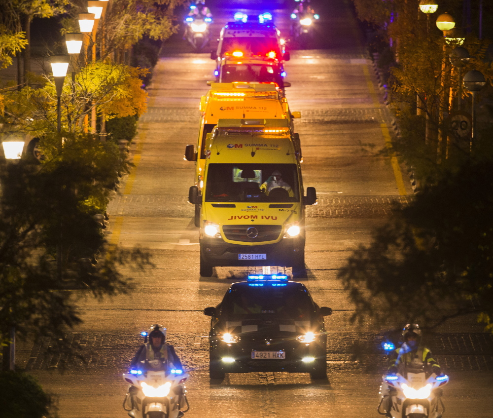 A convoy transports a Spanish nursing assistant believed to have contracted Ebola to Carlos III hospital in Madrid on Tuesday.             leaves Alcorcon Hospital in Madrid, Spain, Tuesday, Oct. 7, 2014. The nurse who treated a missionary for the disease at a Madrid hospital tested positive for the virus, Spain's health minister said Monday. The female nurse was part of the medical team that treated the Spanish priest who died in a hospital last month after being flown back from Sierra Leone, where he was posted. (AP Photo/Andres Kudacki)