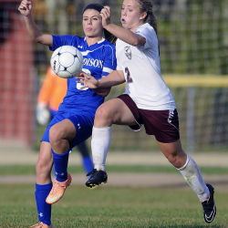 Monmouth Academy's Haley Fletcher, right, races after the ball with Madison Area Memorial High School's Monica Ouellette during a soccer match Monday in Monmouth. Madison won 2-1.