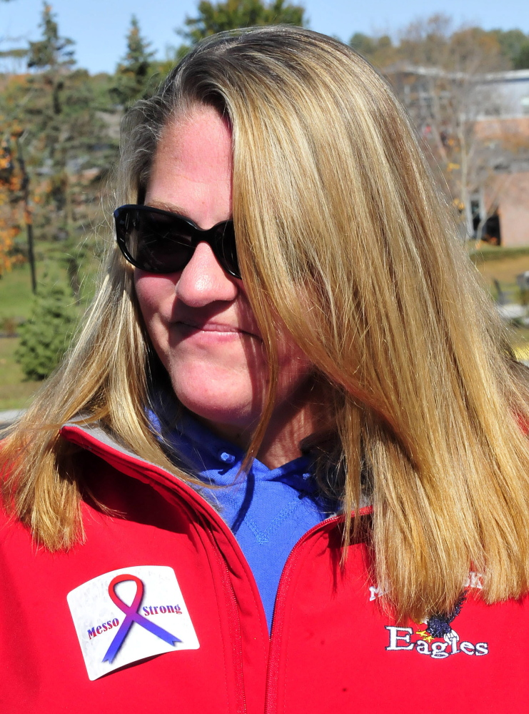 """Kelly Pinney wears a sticker with the words """"Messo Strong"""" in memory of Messalonskee student Cassidy Charette who died in a hayride accident over the weekend and other students who were injured. Pinney was at a Messalonskee and Skowhegan field hockey game on Monday."""