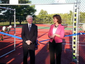 Theodore N. Scontras, executive vice president of The Bank of Maine, and Nancy R. Smith, vice president of The Bank of Maine, celebrate the ribbon cutting for new athletic facilities at Good Will-Hinckley recently. The Bank of Maine, the Eskelund family and the Red Sox Foundation made donations to complete the project.