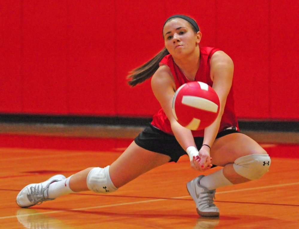Cony's Emily Russell digs the ball during a drill at practice Wednesday in the high school gym in Augusta.