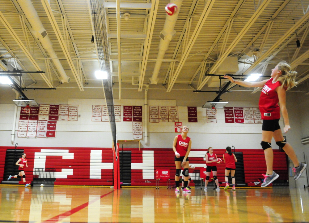 The Cony volleyball team practices drills during practice on Wednesday in the high school gym in Augusta. The team has a shot at a playoff berth with a couple of big wins to end the season.