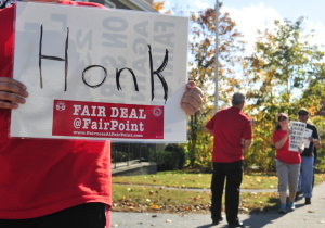 Striking employees walk the picket line along State Street on Friday in front of the FairPoint Communications office at corner of State and Green streets in Augusta.