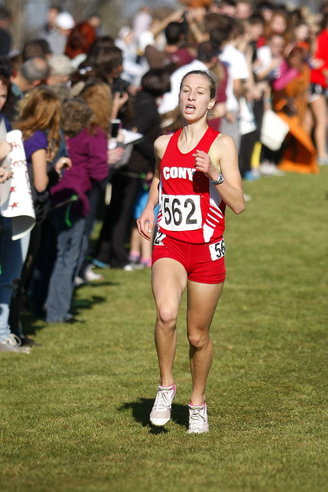 Portland Press Herald file photo by Jill BradyAnne Guadalupi of Cony approaches the finish line at the Class A girls cross country state championships last season. Guadalupi is a favorite in Saturday's Kennebec Valley Athletic Conference Class A championship meet.