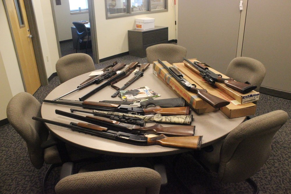Contributed photo Guns that were stolen from a Rockwood homeowner are displayed in the Somerset County Sheriff's Department. The homeowner's stepson, Jason Oliver, was charged with the theft.