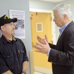 U.S. Rep. Mike Michaud, right, speaks with Aaron Brooker, of Augusta, on Saturday during the 17th Maine Homeless Veterans Stand Down at the Togus veterans' hospital. Veterans from across Maine attended the event to receive medical attention, get access to housing and employment and clothing at the federal hospital for veterans. Brooker, who volunteered to help fellow veterans, attended previous Stand Downs when he was homeless.