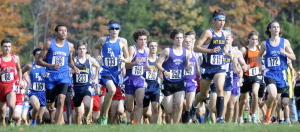 Runners take off for the start of the of the Kennebec Valley Athletic Conference Class A and B boys cross country race Saturday at Cony High School.