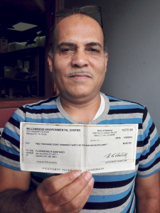 Florentino Santiago holds a bogus check he received on Wednesday. He wants people to know they should never deposit such a check and never pay money in order to collect winnings.