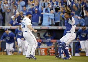 Kansas City Royals relief pitcher Greg Holland and catcher Salvador Perez celebrate after the Royals defeated the Baltimore Orioles 2-1 in Game 4 of the American League baseball championship series on Wednesday.