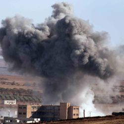 U.S.-led coalition warplanes make an airstrike in Kobani, Syria, Monday. Kobani, also known as Ayn Arab, has been under assault by Islamic State forces since mid-September and is being defended by Kurdish fighters.