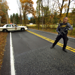 A Pennsylvania State Trooper patrols along a closed section of Lower Swiftwater Road on Saturday, during a massive manhunt for killer Eric Frein in Swiftwater, Pa.