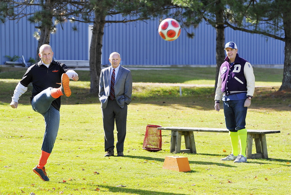 """Local TV sports reporter Lee Goldberg """"tees off"""" on the first tee as Portland Mayor Michael Brennan and comedian Bob Marley wait their turns as Riverside Golf Course introduces footgolf on its South Course on Monday."""