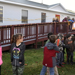 Dresden Elementary School students return to class on Monday after dedicating the Kenyon Center for Arts and Literacy, a modular structure that received a substantial gift from a fund started by the parents of Nate Kenyon.