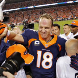 Denver Broncos quarterback Peyton Manning (18) celebrates his 509th career touchdown pass with teammates during the first half Sunday against the San Francisco 49ers in Denver.